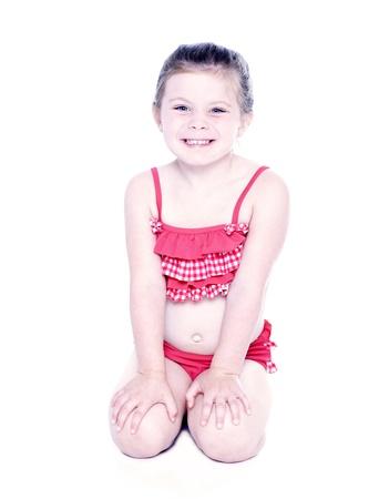 two piece bathing suit: Chica joven en traje de ba�o bikini sobre fondo blanco