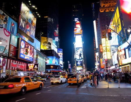 NEW YORK CITY - JUNE 3  Times Square, famous tourist attraction featured with Broadway Theaters and famous restaurant and store locations in New York City, June 3, 2012 in Manhattan, New York City  Stock Photo - 15294447