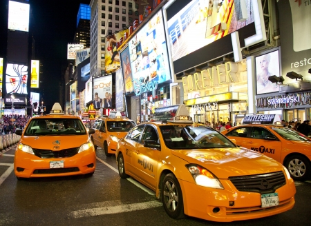 NEW YORK CITY - JUNE 3  Times Square, famous tourist attraction featured with Broadway Theaters and famous restaurant and store locations in New York City, June 3, 2012 in Manhattan, New York City  Stock Photo - 15294451