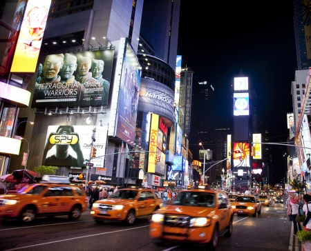 NEW YORK CITY - JUNE 3  Times Square, famous tourist attraction featured with Broadway Theaters and famous restaurant and store locations in New York City, June 3, 2012 in Manhattan, New York City   Editorial