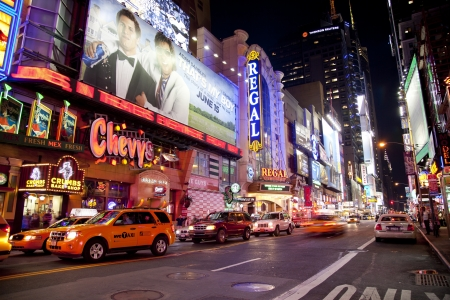 NEW YORK CITY - JUNE 3  Times Square, famous tourist attraction featured with Broadway Theaters and famous restaurant and store locations in New York City, June 3, 2012 in Manhattan, New York City  Stock Photo - 15294456