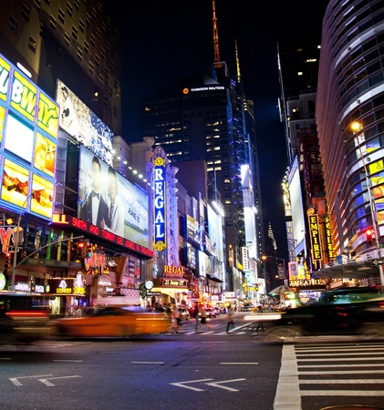 locations: NEW YORK CITY - JUNE 3  Times Square, famous tourist attraction featured with Broadway Theaters and famous restaurant and store locations in New York City, June 3, 2012 in Manhattan, New York City