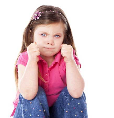 An angry child with fists clenched isolated on white Stock Photo