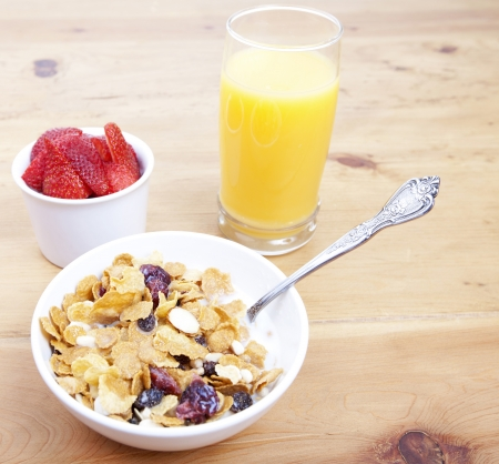 Healthy breakfast of cereal, berries and orange juice photo