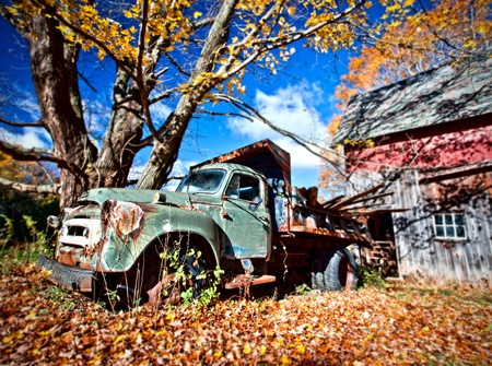 Image of an old abandoned truck and a barn in the Fall photo