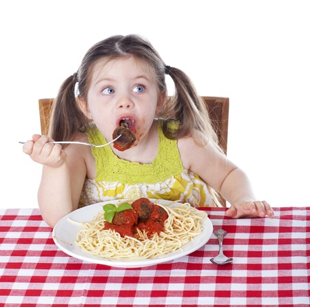 Girl surprised when caught eating a meatball Stock Photo - 16119092
