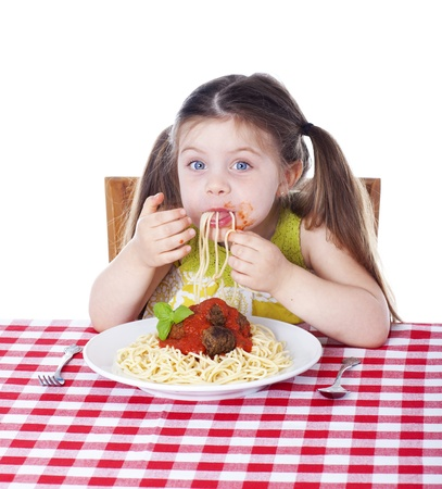 a little dinner: Girl shoving pasta in her mouth