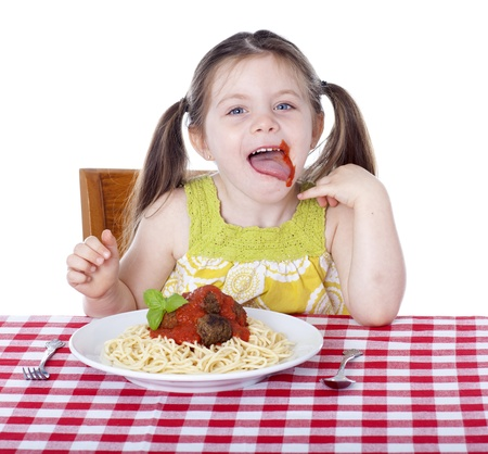 a little dinner: Little girl with sauce all over her face Stock Photo