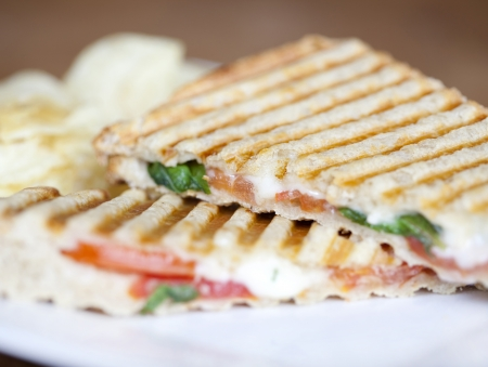 panini: Grilled caprese sandwich with chips Stock Photo