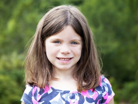 five years old: Pretty young girl portrait smiling outdoors Stock Photo