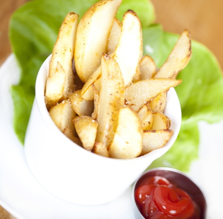 Potato Wedges on plate served with ketchup
