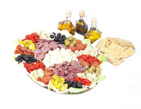 Isolated Antipasto with oils and crackers Standard-Bild
