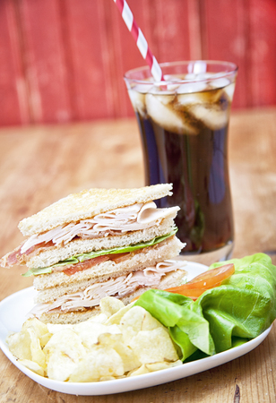 Turkey Club Sandwich with chips and soda