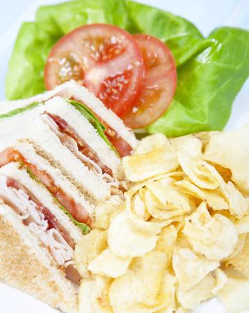 Turkey Club Sandwich with chips Stock Photo
