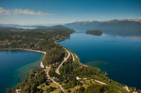 lake nahuel huapi: Flying around Villa La Angostura, Neuquén Province, Argentina, with a view of Lake Correntoso to the left and Lake Nahuel Huapi to the right  Stock Photo