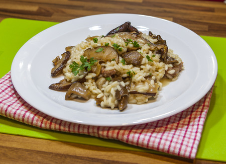 Wild mushroom risotto with herbs and parmesan Stockfoto