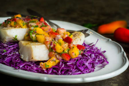 Decontructed Fish Tacos on a bed of cabbage Stock Photo