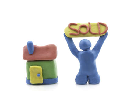 clay modeling: Man and House made from Modeling clay with word sold. Stock Photo