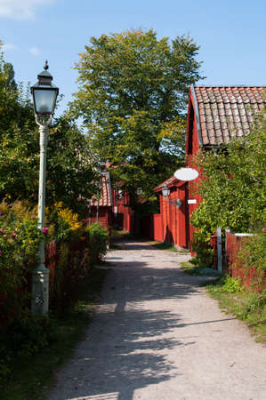 Small idyllic road leading to swedish shop in old town Linkoping