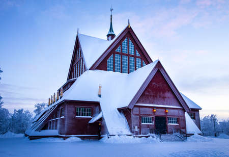 Snow covered church during winter close to dusk at Kiruna in northern Sweden, Lapland