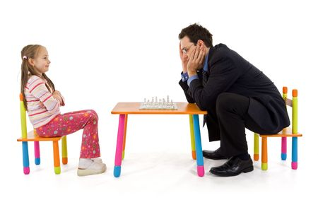 Man and a smart little girl playing chess