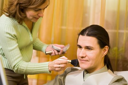 Male model receiving makeup from a woman Stock Photo - 2312504