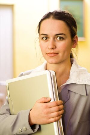 Pretty young woman with silver laptop in hand Stock Photo - 2312495