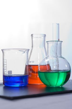 testtube: Various laboratory glassware containing colorful liquid Stock Photo