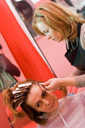Woman's hair being painted at the hair stylist Stock Photo - 2457363