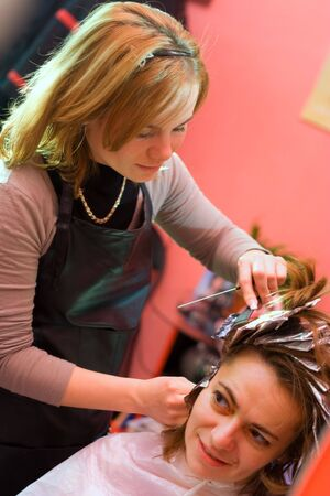 Woman's hair being painted at the hair stylist Stock Photo - 2457360