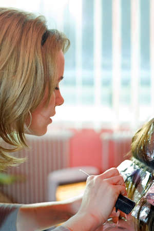 Hair stylist painting hair. Aluminum foils help to bleach separate mops of hair Stock Photo - 2457344