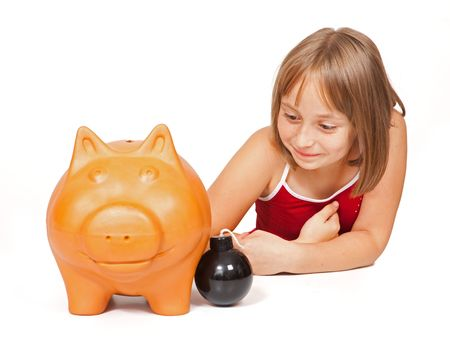Little girl wants to explode the fat, probably full piggy bank photo