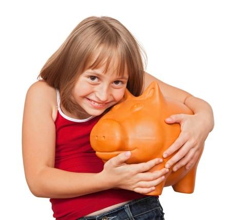 Girl loving her big fat piggy bank full with money photo
