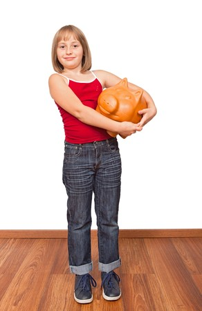 Little girl with big fat piggy bank, proud on savings photo