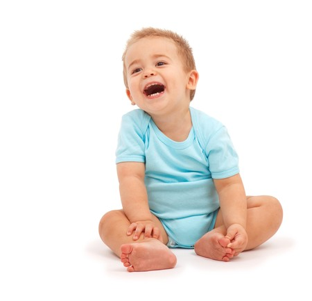 laughing baby: Happy baby boy sitting and laughing Stock Photo