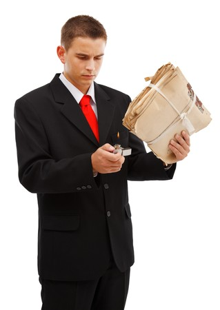 burning man: Young business man burning file folder with lighter, to destroy evidence, archive or other documents