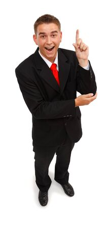 Top view of a business man having a good idea. Happy and pointing with finger upward photo
