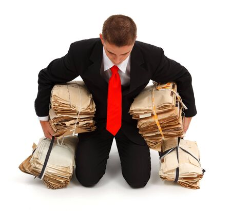 Tired business man fallen on knees, carrying a lot of paperwork