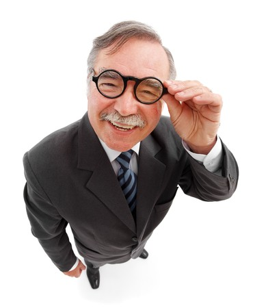 Wide angle top view of a happy senior man, wearing round glasses