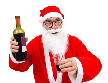 hand holding bottle: Surprised Santa Claus with wine bottle and glass in hand Stock Photo