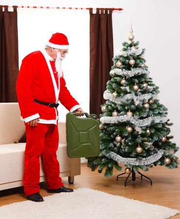 benzine: Santa Claus bringing gas can full of benzine as Christmas Gift