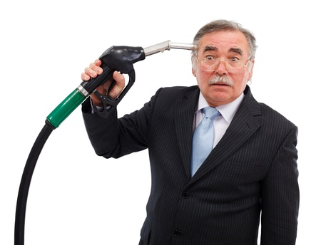 Senior man shooting himself with gas nozzle