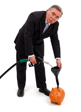 Senior business man filling gas in piggy bank photo
