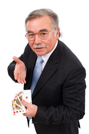 Senior man holding playing cards, showing Royal flush
