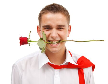 Young man holding a red rose in his mouth photo