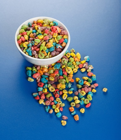 popped: Unhealthy food: popped wheat seeds with lots of artificial colorant Stock Photo