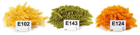 colorant: Bunches of artificially colored twisted pasta, with colorant numbers