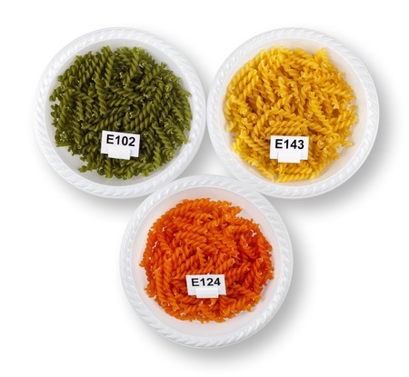 colorant: Top view of artificially colored twisted pasta in plates, with colorant numbers