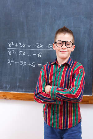 eminent: Eminent math boy in glasses, standing in front of formulas