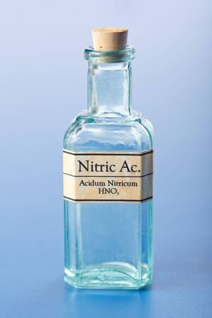 Homeopathic nitric acid in small glass bottle. Acidum Nitricum
